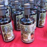 Le bottiglie dell'olio di sant'Imerio sono pronte per la vendita
